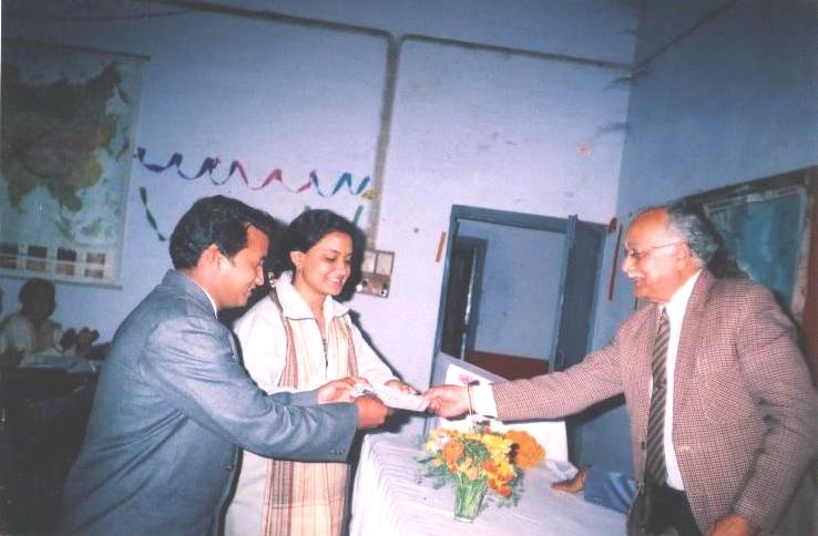"Dr. Ashok Kumar and Savita Singh receiving ""Nishi Gaur Award"" from Chandrashekar Singh"